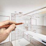 a hand drawing a bathroom design