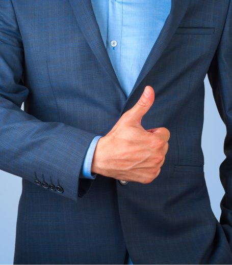 A men wearing smart clothes with his thumb up